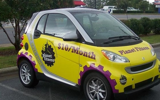 Digital and cut vinyl graphics on a Yellow car